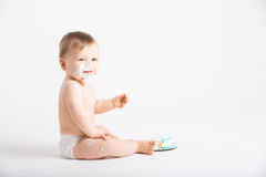 Baby Smiles with Face Full of Cake Frosting Stock Photography