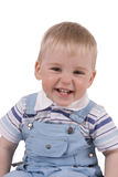 Baby smiles isolated. Child smiles and shows teeth isolated royalty free stock photo