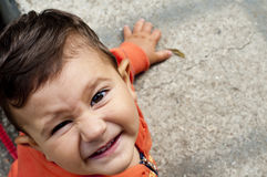 Baby smiling. Laughing baby boy enjoying a summer day Royalty Free Stock Photography