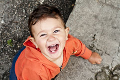 Baby smiling. Laughing baby boy enjoying a summer day Stock Image