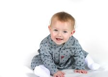 Baby Smiling. A cute baby in gray and blue stars on a white background smiling Stock Images