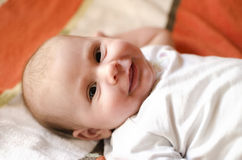 Baby smiling. Portrait of a beautiful baby girl smiling Stock Photography