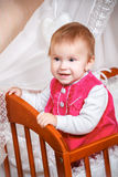Baby smiling in bed Stock Images