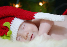 Baby smiling dreaming Santa night before Christmas Stock Photos