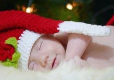 Baby smiling dreaming Santa night before Christmas stock photos