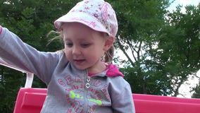 Baby Smiling Riding On A Swing stock video