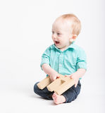 Baby Smiling Sitting Holding Letter E Royalty Free Stock Image