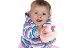 Baby Smiling with Toy. A cute baby on white background holding a rubber duck toy and smilng Stock Photo