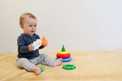 Baby smilling and playing with colorful toys at home. child background with copy space. Early development for children stock images