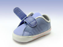 Blue baby shoe with open velcro strap, isolated, clipping path included. Stock Photos