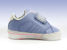 Blue baby shoe with open velcro strap, isolated, clipping path included. Stock Image