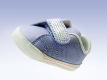 Blue baby shoe with velcro strap, isolated, clipping path included, in air. Baby sneaker with open velcro strap, isolated, clipping path included Stock Photography