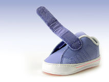 Blue baby shoe with open velcro strap, isolated, clipping path included. Royalty Free Stock Photography