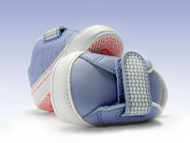 Blue baby shoes with velcro strap, isolated, clipping path included. Royalty Free Stock Photo