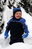 Baby in snow. Beautiful blond baby playing in snow Stock Photography