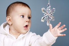 Baby with snow flake Royalty Free Stock Photography