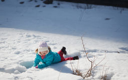 Baby in snow. Little baby girl playing and having fun in the snow, during the winter holidays Royalty Free Stock Photos
