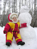 Baby with snowman. Baby sit with snowman royalty free stock images