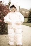 Baby in Snowsuit. Picture of a child wearing snowsuit during winter Stock Photo