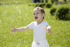 Baby and soap bubbles Royalty Free Stock Image