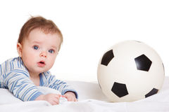 Baby with soccer ball. Baby lying beside soccer ball Royalty Free Stock Photography