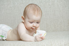 Baby with sock Stock Photos