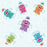 Baby sock monkeys make snow angels Royalty Free Stock Image