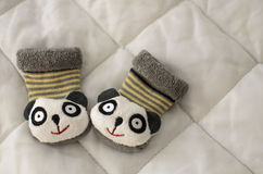 Baby socks animal face. On a blanket Stock Images