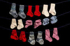 Baby socks on black background Royalty Free Stock Images