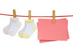 Baby socks and blank note hanging Royalty Free Stock Photo