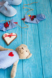 Baby socks on clothes line, gingerbread heart and bear Stock Photos