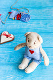 Baby socks on clothes line, gingerbread heart and bear Royalty Free Stock Image