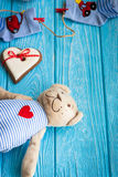Baby socks on clothes line, gingerbread heart and bear Stock Photography