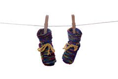 Baby socks drying on line Stock Photo