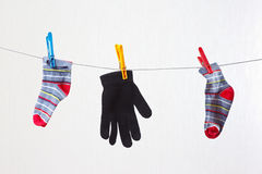 Baby socks and gloves are drying on a clothesline Royalty Free Stock Photo