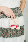 Baby socks in  hands of pregnant woman Stock Photo