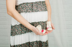 Baby socks in  hands of pregnant woman Stock Photography