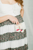 Baby socks in  hands of pregnant woman Stock Images