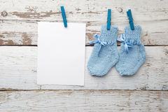 Baby socks hanging on white wooden background. Flat lay Royalty Free Stock Photos