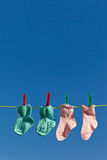 Baby socks on laundry line to dry Royalty Free Stock Photography