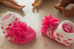 Baby socks and legs dolls Royalty Free Stock Images