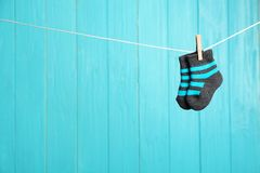 Free Baby Socks On Laundry Line Against Color Wooden Background, Space For Text. Stock Images - 147755234