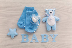 Baby socks and a pacifier lying stock image