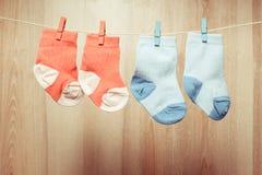 Baby socks on rope royalty free stock photo