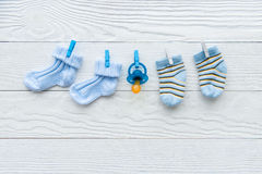 Baby socks on rope at wooden background Royalty Free Stock Images