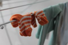 Baby socks. There are Orange and White Socks and Tights Stock Photos