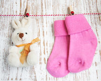 Baby socks and toy Royalty Free Stock Image