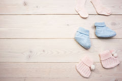 Baby socks on wooden surface royalty free stock photo