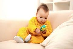 Baby on sofa Stock Photo
