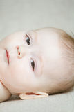 Baby on sofa face Stock Images